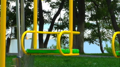 Swing swaying at children playground  Stock Footage