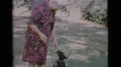 1968: bliss in the elderly with the best friend of man in a great day  Stock Footage