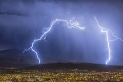 Lightning during a thunderstorm over the city of Cochabamba, Bolivia Stock Photos