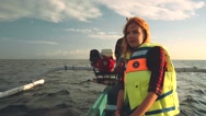 Young woman in life jacket on a small boat Stock Footage