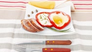 Fried eggs and tortilla with salad on white plate Stock Footage