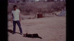 1968: man playing with his dog COTTONWOOD, ARIZONA Stock Footage