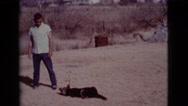 1968: man playing with his dog COTTONWOOD, ARIZONA Stock Footage