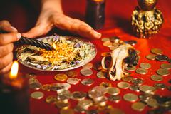 A witch holds a ritual for money Stock Photos