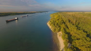 Cargo ship in green river water. Stock Footage