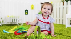 A baby playing by his crib in his room Stock Footage