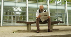 4k, Hipster businessman reading a newspaper while on a lunch break Stock Footage