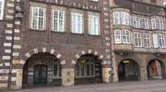 4k Historic city buildings in Bremen panning with archway passage Stock Footage