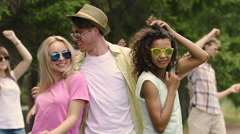 Sexy girls seducing handsome man, people having fun, dancing at summer party Stock Footage