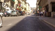 FRANCE NICE, A cyclist rides down on a small quiet street in Stock Footage