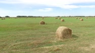 Aerial flying away a hay roll Stock Footage
