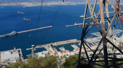 Gibraltar cable car ascending the rock. City in background Stock Footage