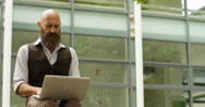 4k, Shot of a successful hipster businessman working on his laptop. Slow motion. Stock Footage