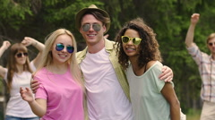 Happy man dancing with beautiful girls at party, participants of talent show Stock Footage