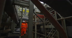 4K Male & female engineers conducting checks inside power plant Stock Footage