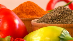 Different types of pepper in a wooden mortar. Macro Stock Footage