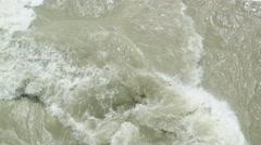 Rapid stream of muddy river Stock Footage