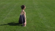 Yoga and stretching muscles in park Stock Footage
