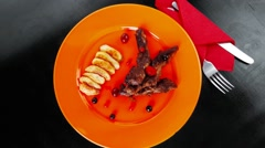 Beef meat with berries fried potatoes and cherry under sweet sau Stock Footage