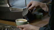 Pouring milk into coffee Stock Footage