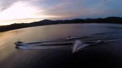 Wakeboard jump at sunset aerial Stock Footage
