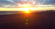Flying towards the waves at sunset (aerial) (Lincoln City, OR) Stock Footage