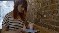 Woman with coffee and tablet Stock Footage