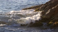 Beautiful blue waves crashing into the coast Stock Footage