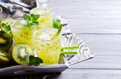 Cocktail with kiwi and mint Stock Photos