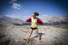 A young woman stands atop Parker Ridge, Banff National Park, Alberta, Canada Stock Photos