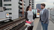 Man and woman on platform Stock Footage