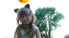 Girl child with glasses shows a cat. Stock Footage