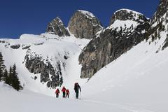 Small group of people backcountry skiing on the snowy summits of Valhalla Stock Photos