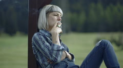 Female smoking in countryside Stock Footage