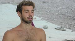 A Yogi meditates during yoga session during Yoga Arava Stock Footage