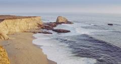 Aerial over beautiful sandy beach and cliff in california, , Santa Cruz Stock Footage