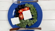 White goat cheese on blue plate Stock Footage