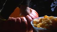 Gut seeds and flesh from a Halloween pumpkin Stock Footage