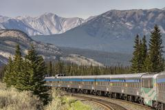 Passenger train going through the Rocky Mountains in Jasper National Park, Stock Photos