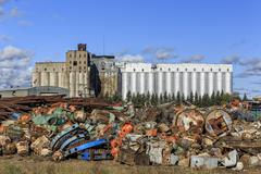 Scrap metal recycling, with an abandoned grain elevator in background, Thunder Stock Photos