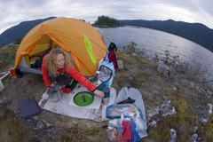 Woman in tent, camping at Kunechin Point, Sechelt Inlet, Gibsons, Sunshine Stock Photos