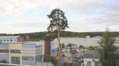 Industrial landscape with warehouses at outskirts of town Stock Footage