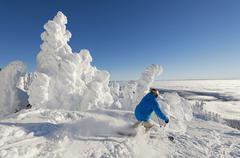 A skier among snow ghosts cuts tracks in the powder in a beautiful environment Stock Photos