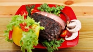 Beef on red plate with peppers Stock Footage