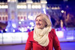 Senior woman on a walk in night city. Winter Stock Photos
