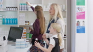 4K Worker in a chemist shop serving customers at the till.  Stock Footage