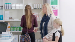 4K Worker in a chemist shop serving customers at the till Stock Footage