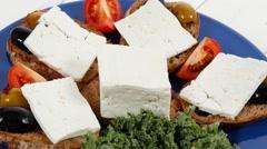White feta greek cheese sandwich on blue plate Stock Footage