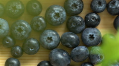 A lot of blueberries lying wooden surface. Dolly shot. Stock Footage