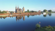 Big church at Maas river with reflection,Cuijk,Netherlands Stock Footage